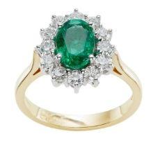 Gold Emerald gemstone platinum Halo engagement ring in hatton garden