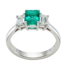 Platinum Emerald gemstone diamond trilogy ring in hatton garden